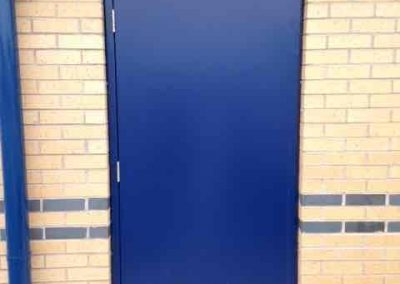 Steel hinged personnel doorset.