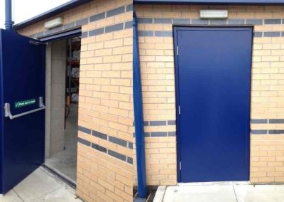 Alliance Door Engineering fitting steel hinged personnel doors.
