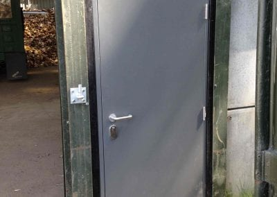 A steel hinged personnel door