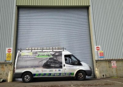 Alliance Door Engineering fitter's van outside a power operated roller shutter