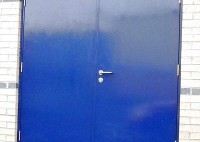 A double steel hinged personnel doorset