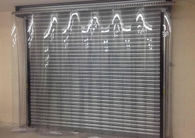Strip Curtain in front of Roller Shutter