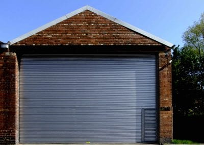 Wicket Gate / Wicket Door set into a S11 Power Operated Roller Shutter